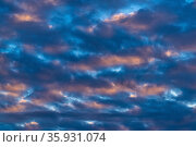 Dramatic clouds in blue sky, illuminated by rays of sun at colorful sunset to change weather. Abstract meteorology background. Стоковое фото, фотограф А. А. Пирагис / Фотобанк Лори