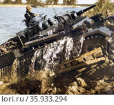 German World War Two Panzer Mark iii tank, crossing a river on the Eastern Front. Редакционное фото, агентство World History Archive / Фотобанк Лори