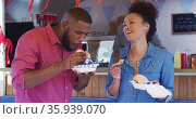 African american couple eating burgers and fries together at the food truck. Стоковое видео, агентство Wavebreak Media / Фотобанк Лори