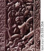 Yaksa and bird, from a doorway at Mandapa. Rajiva Locana Temple Madhya Pradesh, India. Редакционное фото, агентство World History Archive / Фотобанк Лори