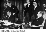 Russian Ambassador Potemkin signs treaty with French Prime Minister Pierre Laval, 1935. Редакционное фото, агентство World History Archive / Фотобанк Лори