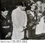 Photographic print of Crown Prince Michael and his Father King Carol of Romania during a mass in Bucharest. Редакционное фото, агентство World History Archive / Фотобанк Лори