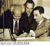 Photograph of David Ben-Gurion signing the proclamation of independence for Israel. Редакционное фото, агентство World History Archive / Фотобанк Лори