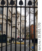 Security gates with raised road ramp at the entrance to Downing Street London. Редакционное фото, агентство World History Archive / Фотобанк Лори