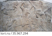 Wall frieze depicting a king or noble on horseback defeating an enemy. Assyrian, about 865-860 BC. Редакционное фото, агентство World History Archive / Фотобанк Лори