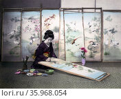 Hand-coloured photograph of a Japanese woman painting a screen by Felice Beato. Редакционное фото, агентство World History Archive / Фотобанк Лори