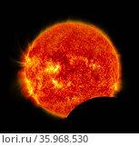Solar Dynamics Observatory Captures Images of Lunar Transit 2012. Редакционное фото, агентство World History Archive / Фотобанк Лори