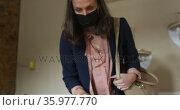 Caucasian woman wearing face mask, touching glass surface, shopping for jewelry. Стоковое видео, агентство Wavebreak Media / Фотобанк Лори