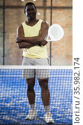 African american man with racket in his hands on the padel court. Стоковое фото, фотограф Яков Филимонов / Фотобанк Лори