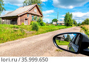 Rural landscape with village wooden houses and reflection in the rearview... Стоковое фото, фотограф Zoonar.com/Alexander Blinov / easy Fotostock / Фотобанк Лори