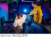 Two gamers talking at the monitor in gaming club. Стоковое фото, фотограф Tryapitsyn Sergiy / Фотобанк Лори