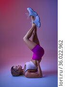 Sportswoman standing on her back in studio. Стоковое фото, фотограф Tryapitsyn Sergiy / Фотобанк Лори
