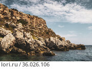Rocky cliff face on south east coast of Menorca, Spain - Europe. ... Стоковое фото, фотограф Mehul Patel / age Fotostock / Фотобанк Лори