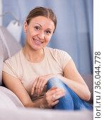 Positive woman relaxing on sofa. Стоковое фото, фотограф Яков Филимонов / Фотобанк Лори