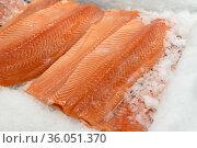 Many fillet of salmon lie on ice. Стоковое фото, фотограф Володина Ольга / Фотобанк Лори