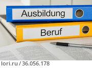 Folders with the german label Ausbildung und Beruf - Training and... Стоковое фото, фотограф Zoonar.com/Boris Zerwann / easy Fotostock / Фотобанк Лори