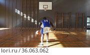 African american male basketball player practicing shooting with ball. Стоковое видео, агентство Wavebreak Media / Фотобанк Лори