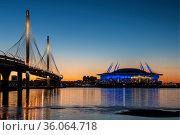 """Stadium """"Gazprom Arena"""" on Krestovsky island and Cable-stayed bridge Western high-speed diameter across Peter's fairway in St. Petersburg at sunset, Russia (2018 год). Редакционное фото, фотограф Наталья Волкова / Фотобанк Лори"""