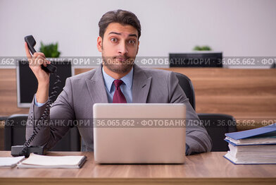Young businessman employee working in the office