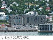 Akureyri, Iceland - July 27, 2017: View on modern Hof Cultural and... Стоковое фото, фотограф Zoonar.com/Jiri Vondrous / age Fotostock / Фотобанк Лори