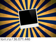 Front view of black polaroid photograph on abstract starburst background... Стоковое фото, фотограф Zoonar.com/Ekin Yalgin / age Fotostock / Фотобанк Лори