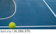 Composition of tennis ball and racket with copy space on tennis court. Стоковое фото, агентство Wavebreak Media / Фотобанк Лори