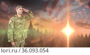 Composition of soldier saluting against sunset and american flag. Стоковое фото, агентство Wavebreak Media / Фотобанк Лори