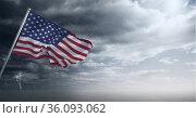 Composition of waving american flag against stormy sky and seaside. Стоковое фото, агентство Wavebreak Media / Фотобанк Лори