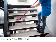 Cleaning service concept. Woman clean stair at home. Стоковое фото, фотограф Zoonar.com/Max / easy Fotostock / Фотобанк Лори