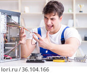 Computer hardware repair and fixing concept by experienced techn. Стоковое фото, фотограф Elnur / Фотобанк Лори