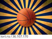 Front view of basketball on abstract starburst background. Стоковое фото, фотограф Zoonar.com/Ekin Yalgin / age Fotostock / Фотобанк Лори