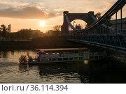 """Poland, Wroclaw - Excursion boat on the river Oder passing under the Grunwald Bridge (Most Grunwaldzki)"" (2018 год). Редакционное фото, агентство Caro Photoagency / Фотобанк Лори"