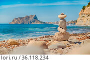 Art of stone balance, piles of stones on the Cala Baladrar beach.... Стоковое фото, фотограф Zoonar.com/ALEXTIHONOV.COM / easy Fotostock / Фотобанк Лори