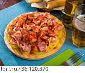 Spanish dish - roasted pig ears. Стоковое фото, фотограф Яков Филимонов / Фотобанк Лори