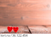 Two pink happy smiling hearts on wooden background. Стоковое фото, фотограф Zoonar.com/Ivan Mikhaylov / easy Fotostock / Фотобанк Лори