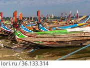 Colourful boats in front of the U Bein bridge. Стоковое фото, фотограф Zoonar.com/Christian Offenberg / easy Fotostock / Фотобанк Лори