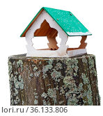 Homemade spring birdhouse mounted on an old forest mossy stump. Isolated... Стоковое фото, фотограф Zoonar.com/Aleksandr Volkov / easy Fotostock / Фотобанк Лори