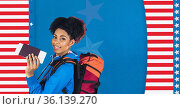 Composition of smiling woman holding passport and ticket over stars and stripes of american flag. Стоковое фото, агентство Wavebreak Media / Фотобанк Лори