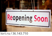 Reopening Soon Signage board in front of Businesses or Restaurant... Стоковое фото, фотограф Zoonar.com/lakshmiprasad maski / easy Fotostock / Фотобанк Лори