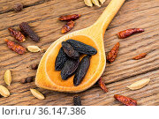 Closeup of whole tonka beans on an old wooden wooden spoon on rustic... Стоковое фото, фотограф Zoonar.com/Thomas Klee / easy Fotostock / Фотобанк Лори