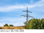 Energy and electricity industry, power lines, electrical equipment and high-voltage wires on the mountain near the forest against the background of nature and the sky. Стоковое фото, фотограф Светлана Евграфова / Фотобанк Лори