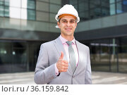 Businessman in hardhat showing thumbs up. Стоковое фото, фотограф Яков Филимонов / Фотобанк Лори
