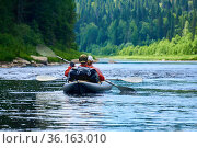 Couple in a two-seater kayak rafting down the river among the mountains. Стоковое фото, фотограф Евгений Харитонов / Фотобанк Лори