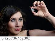 Female is looking through glass stone. Стоковое фото, фотограф Serg Zastavkin / Фотобанк Лори