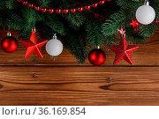 Christmas decoration frame on wooden background, fir tree branch,... Стоковое фото, фотограф Zoonar.com/Ivan Mikhaylov / easy Fotostock / Фотобанк Лори
