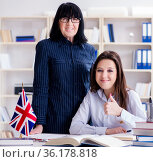 Young foreign student during english language lesson. Стоковое фото, фотограф Elnur / Фотобанк Лори