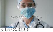 Caucasian female doctor wearing face mask at home with swab test. Стоковое видео, агентство Wavebreak Media / Фотобанк Лори