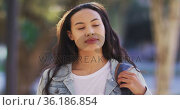 Portrait of asian woman touching her hair and smiling. Стоковое видео, агентство Wavebreak Media / Фотобанк Лори