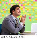 Businessman with many conflicting priorities. Стоковое фото, фотограф Elnur / Фотобанк Лори