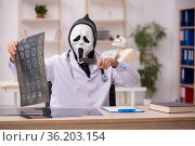Devil doctor radiologist working in the clinic. Стоковое фото, фотограф Elnur / Фотобанк Лори